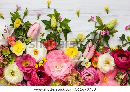 Flowers frame on white wooden background. Top view with copy space #361678730