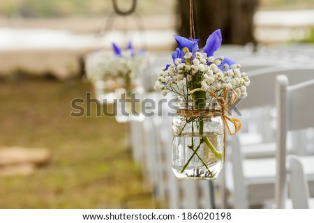 flowers hanging in mason jar at wedding