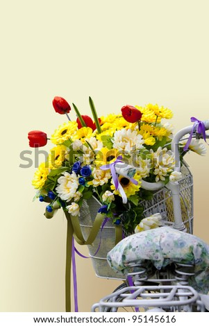 Flowers in a basket of an decorative old bicycle