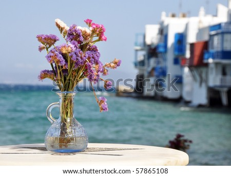 Flowers in small tavern in Small Venice in Mykonos island