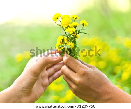 flowers in the man hand to the woman