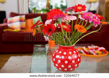 Flowers in vase at the table in interior