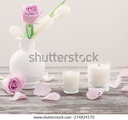 flowers in vase with scented candle