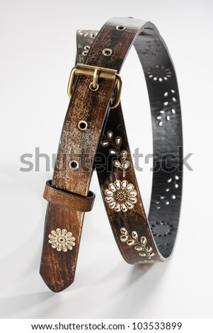 Flowers leather belt, close up