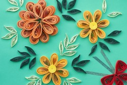 flowers made quilling on a light background