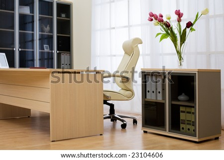Flowers on a background of a window at modern office