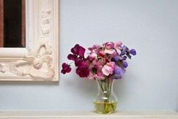 Flowers on a mantle piece in a vintage home