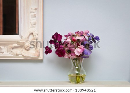 flowers on a mantle piece in a...