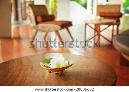 Flowers on a table in a hotel - stock photo