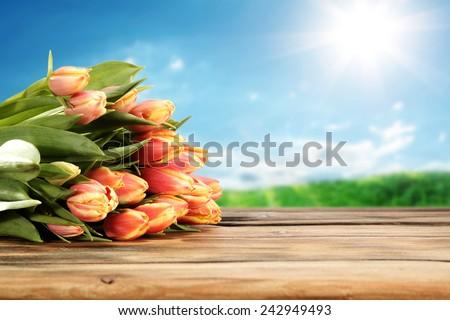 flowers on desk of tulips