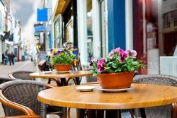 Flowers on the tables of street cafes. Gorinchem. Netherlands
