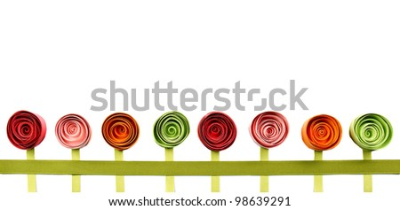 Flowers, paper quilled, growing in a line. Isolated on white.