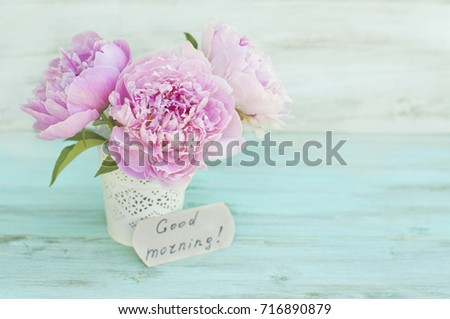 """Flowers, peonies on a turquoise background and the inscription """"Good morning"""", a graphical resource, a postcard"""