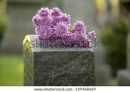 flowers rest on headstone in...