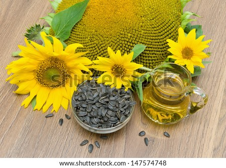 flowers sunflower, seeds and sunflower oil close-up. horizontal photo.
