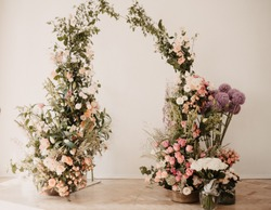 flowers wedding archs bohemian style.Wedding ceremony arch with flowers in rustic style. Wedding ceremony with fresh flowers