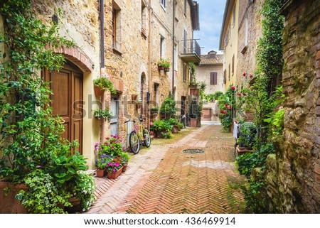 stock photo flowery streets on a rainy spring day in a small magical village pienza tuscany 436469914 - Каталог — Фотообои «Улицы, переулки»