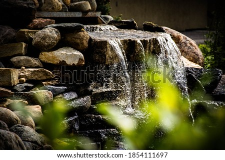 flowing water over river rocks