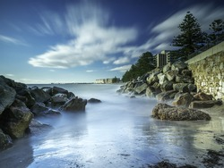 Flowing water rolling over rocks at beach in Adelaide, South Australia, Australia