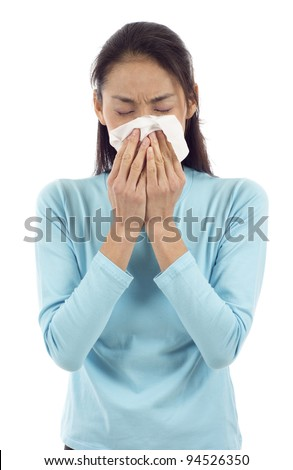 Flu or cold - sneezing woman sick blowing nose isolated over white background