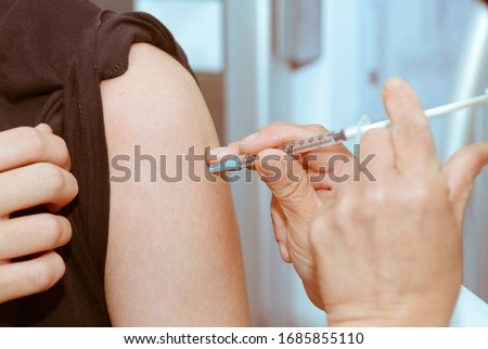 Flu Vaccination Injection on Arm
