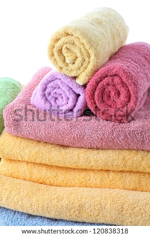 Fluffy and colorful bath towels, close up, isolated
