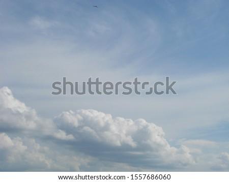 Fluffy clouds bright blue summer sky cloudscape nature background #1557686060