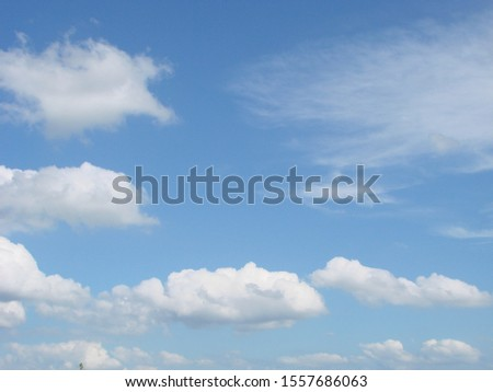 Fluffy clouds bright blue summer sky cloudscape nature background #1557686063