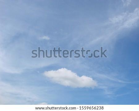 Fluffy clouds bright blue summer sky cloudscape nature background #1559656238