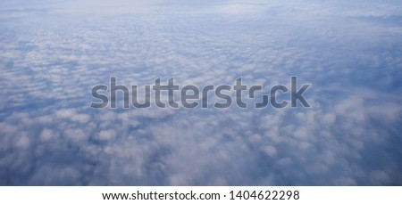 Fluffy clouds from airplane view background texture, soft cloudscape pattern.   #1404622298