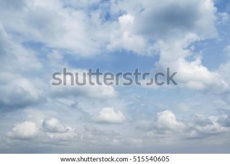 Fluffy clouds in a blue sky  #515540605