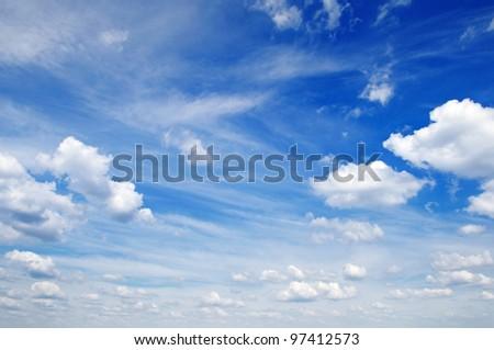 fluffy clouds in the blue sky - Shutterstock ID 97412573