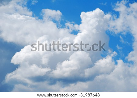 Fluffy clouds on blue sky
