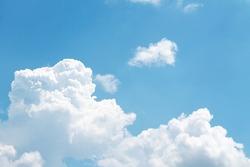 Fluffy clouds patterns on bright bluesky background