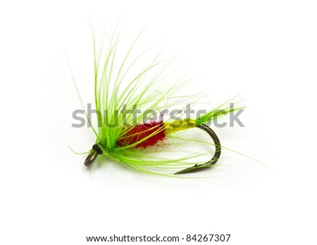 Fluffy fly fishing hook isolated on white
