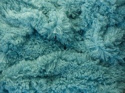 Fluffy fur fabric macro texture for background or template. Fuzzy fabric for winter day. Tidewater green fur, winter fabric textile.