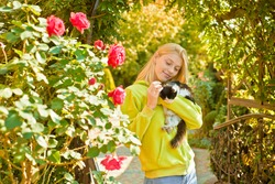 Fluffy kitten. Adorable girl hug cat. Enjoy autumn season. Autumn is here. Pretty woman carry cat animal. Woman love animals nature background. Warmth and coziness. Happy autumn day with friend.