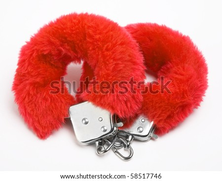 fluffy pink handcuffs on white background