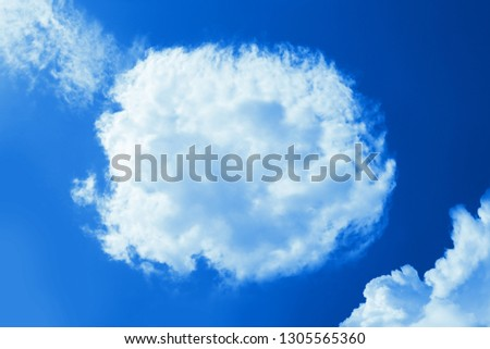 Fluffy round cloud in clear blue sky. Peaceful cloudy sky natural background, frame. Sunny day, light. Divine shining heavenly background, heaven #1305565360