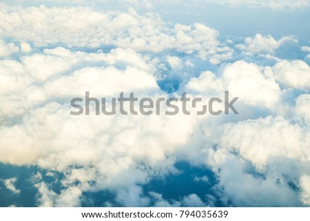 Fluffy sky cloud above view from airplane atmosphere background - Shutterstock ID 794035639