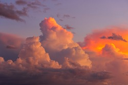 Fluffy white and pink clouds.