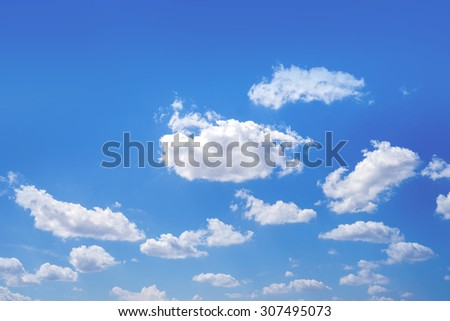 Fluffy white clouds in a blue sky #307495073