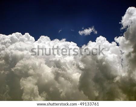 stock-photo-fluffy-white-clouds-under-beautiful-sky-49133761.jpg