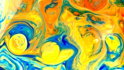 Fluid art photography. Abstract blurred colorful background. Swirl liquid pattern. Marble effect of blue yellow color. Trendy backdrop. Mixing paints