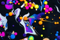 Fluid art texture. Abstract backdrop with mixing paint effect. Liquid acrylic artwork with flowing bubbles. Mixed paints for background or poster. Black and neon overflowing colors.