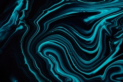 Fluid art texture. Abstract backdrop with swirling paint effect. Liquid acrylic artwork that flows and splashes. Mixed paints for posters or wallpapers. Blue, black and aquamarine overflowing colors.