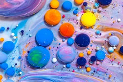 Fluid art texture. Background with abstract mixing paint effect. Liquid acrylic picture that flowing bubbles. Mixed paints for background or poster. Bright overflowing colors.