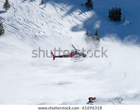 FLUMSERBERG - FEBRUARY 21: The rescue helicopter evacuates skiier after heavy accident, Flumserberg, Switzerland on February 21, 2010. Skiing safety becoming an issue on crowded slopes.