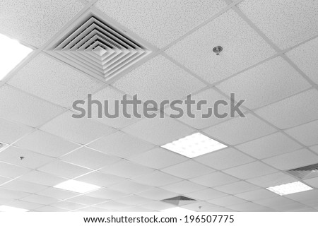 Fluorescent lamp on the modern ceiling