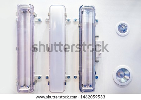 Fluorescent lamp with a transparent plafond. Fluorescent lamp with frosted plafond. Room lighting. Lighting of apartments, offices and industrial premises. Daylight lamp. Fluorescent lamp.